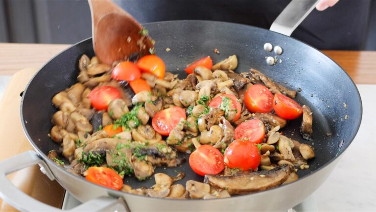 adding parsley and tomatoes