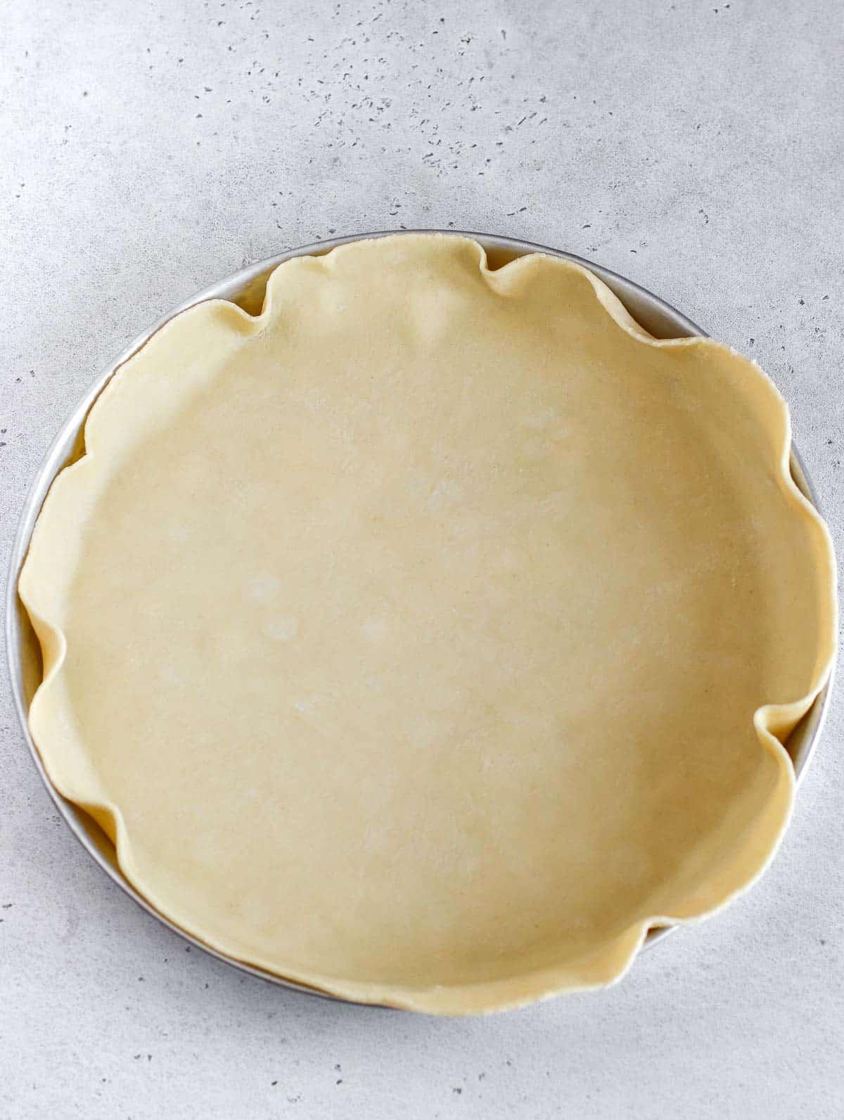 pie dish with the pie crust inside
