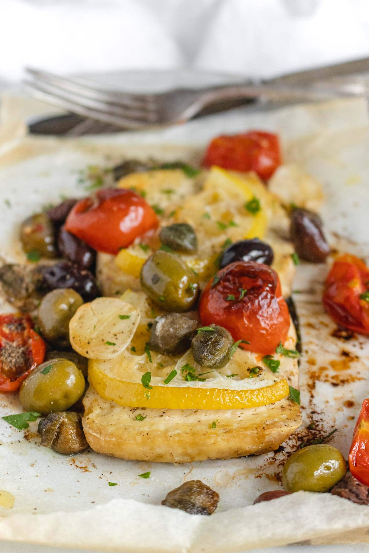 baked tofu with lemon, tomatoes, olives and capers