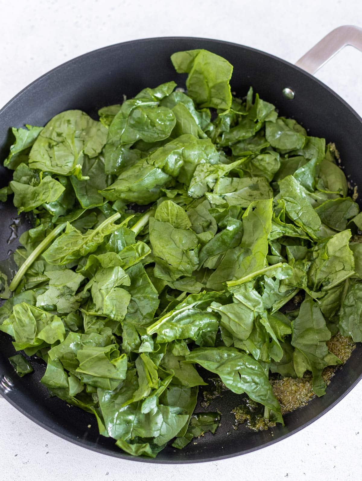pan frying the spinach for the lemon pasta