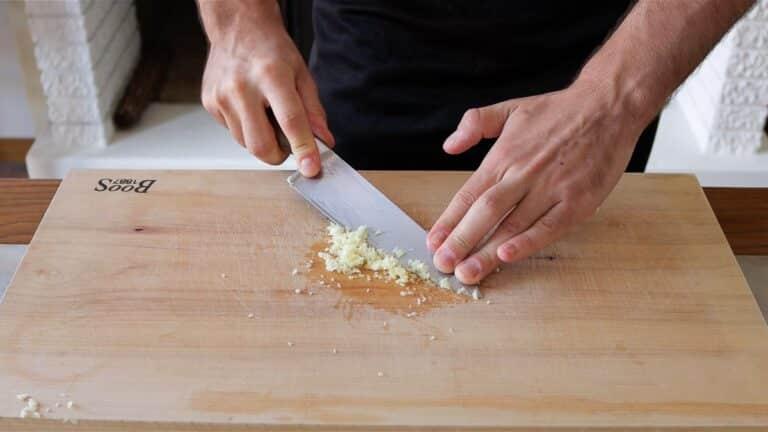 mashing garlic