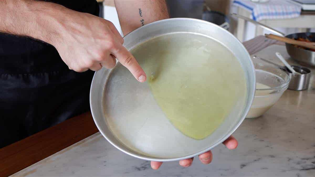 adding oil to a baking tray