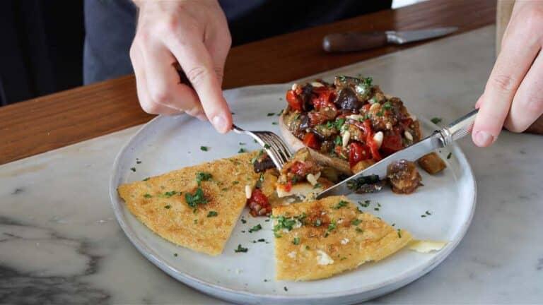 serving farinata with eggplant caponata