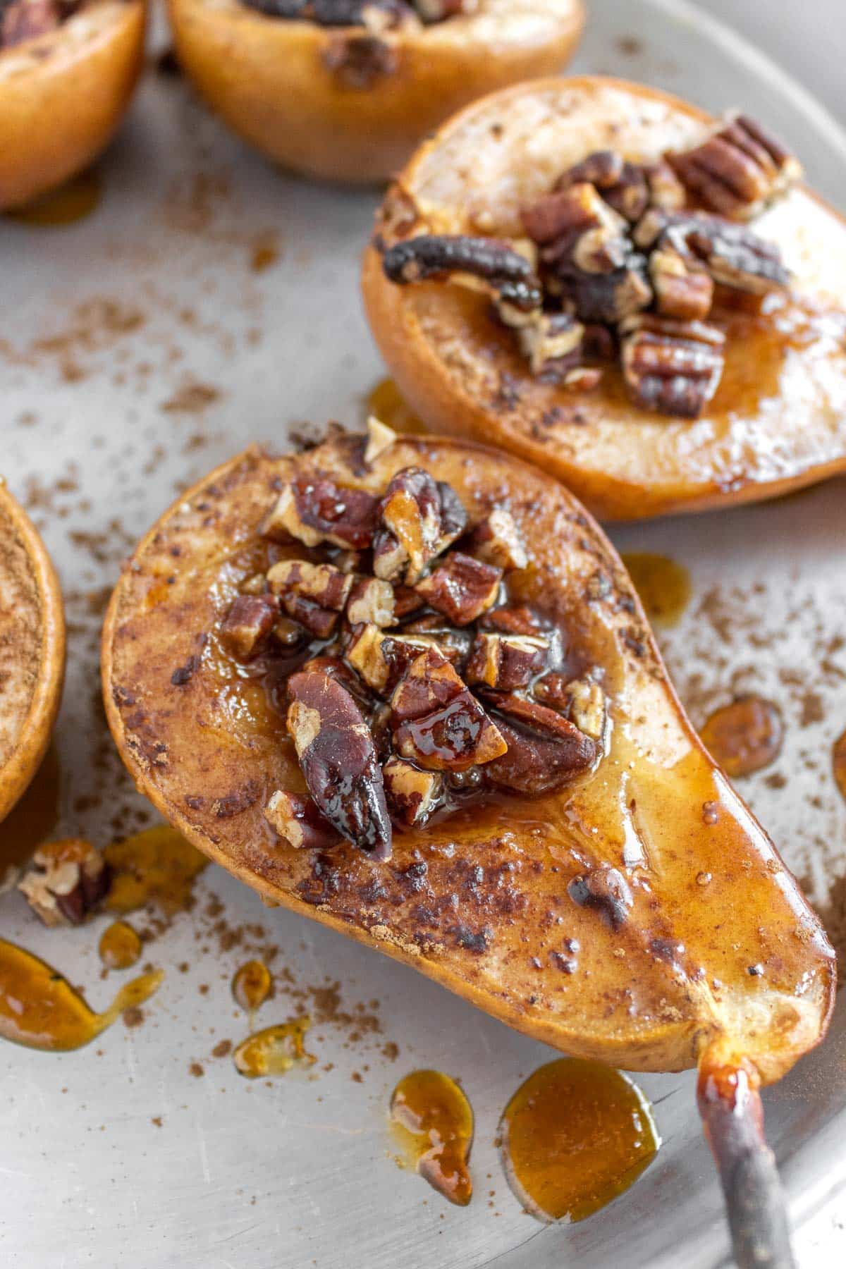 baked pears with cinnamon, maple syrup and pecan