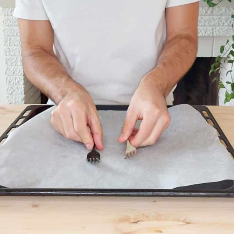 prepping baking paper and two forks