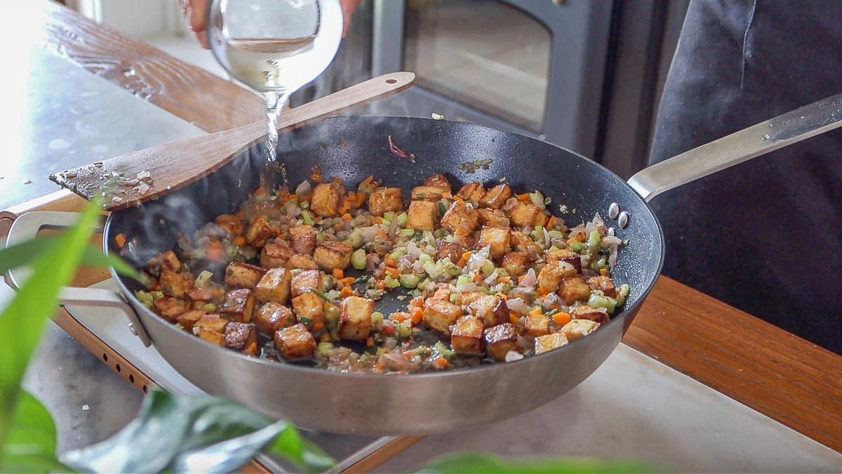 adding wine to the pan