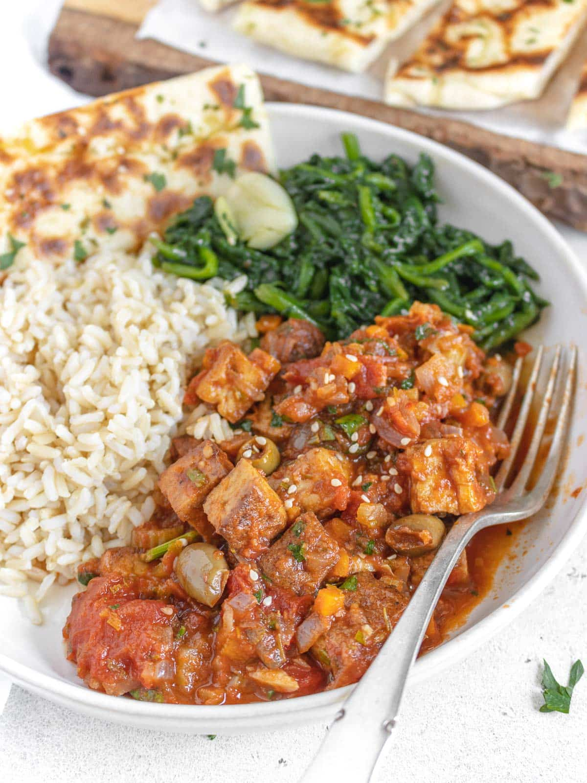 tofu cacciatore served with rice and spinach