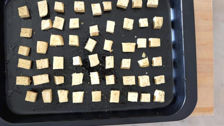 arranging the tofu cubes on a baking tray